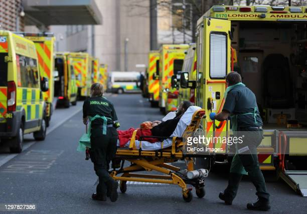 Emergency staff carry a patient outside Royal London Hospital on January 22, 2021 in London, United Kingdom.