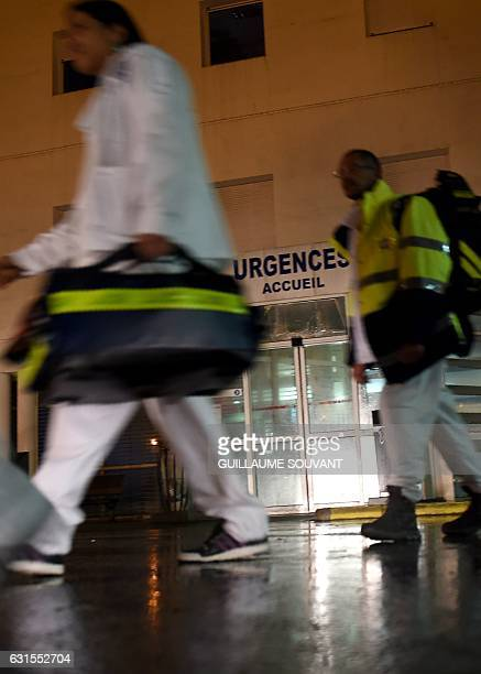 Emergency staff walk past the entrance of he emergency department of the hospital of Trousseau in Tours on January 12 2017 French hospitals are being...