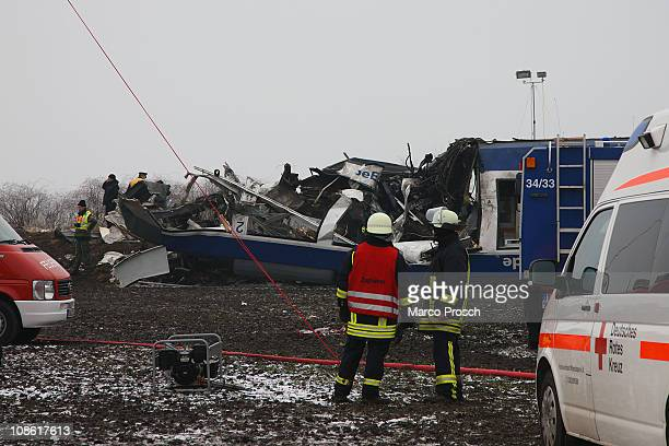 Emergency staff work at the scene of an accident where a passenger train collided head on with a goods train on January 30 2011 in Hordorf near...