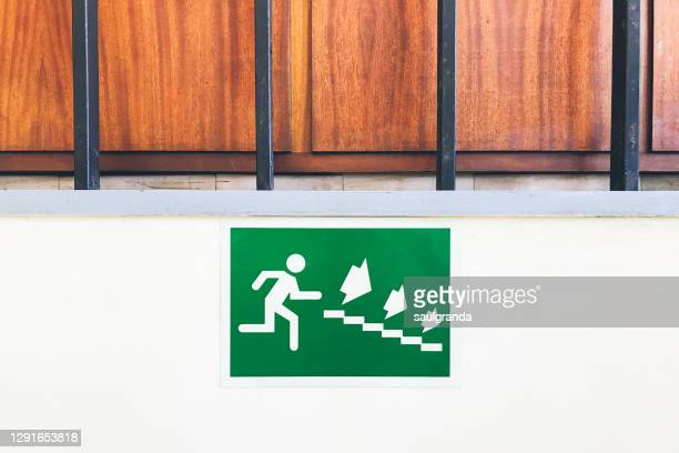 emergency stairs exit sign - evacuation stock pictures, royalty-free photos & images