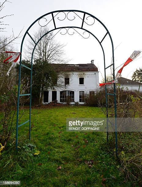 Emergency team tape is pictured at the scene of a house fire in Hanzinne Florennes on December 24 2012 after a blaze brokeout around 4am killing a...