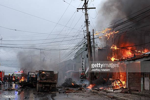 Emergency teams attend the scene following a powerful car bomb explosion on August 5 2013 in the southern Philippine city of Cotabato The deadly...