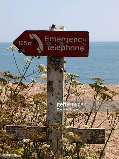 Emergency Telephone sign with snails on it Slapton Sands Devon UK