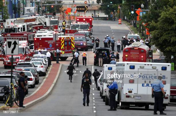 Emergency vehicles and law enforcement personnel respond to a reported shooting at an entrance to the Washington Navy Yard September 16 2013 in...