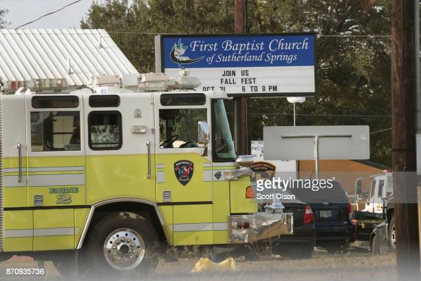 Emergency vehicles are parked outside the first Baptist Church of Sutherland Springs as law enforcement officials continue their investigation of a...