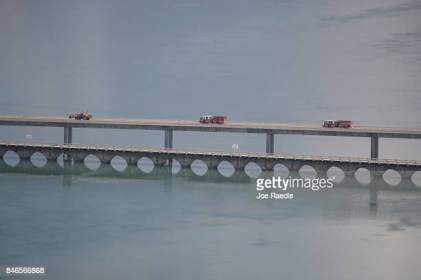 Emergency vehicles are seen on the Overseas highway after Hurricane Irma passed through the area on September 13 2017 in Ramrod Key Florida The...
