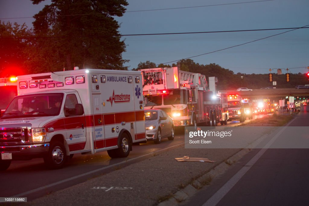 Emergency vehicles from three states line up in a staging area after an outbreak of gas fires in Lawrence and surrounding communities on September 13, 2018 in Lawrence, Massachusetts. Dozens of fires broke out in Lawrence, North Andover and Andover because of the gas lines.