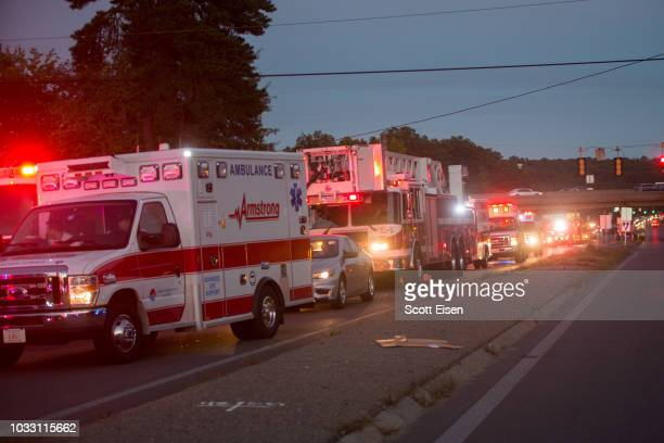 Emergency vehicles from three states line up in a staging area after an outbreak of gas fires in Lawrence and surrounding communities on September 13...