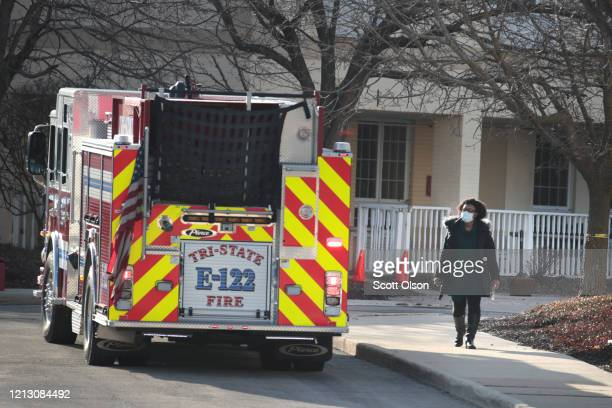 Emergency vehicles sit in front of the Chateau Nursing and Rehab Center on March 17, 2020 in Willowbrook, Illinois. Earlier today Illinois Gov. J.B....