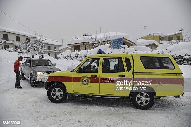 Emergency vehicles wait in the snow in Montereale's main street near Amatrice after a 57magnitude earthquake struck the region on January 18 2017...