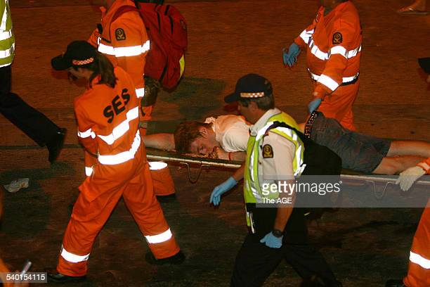 SES Emergency workers carry a sick party goer through the crowds at Schoolies in Surfers Paradise Gold Coast QLD 18 November 2006 THE AGE Picture by...