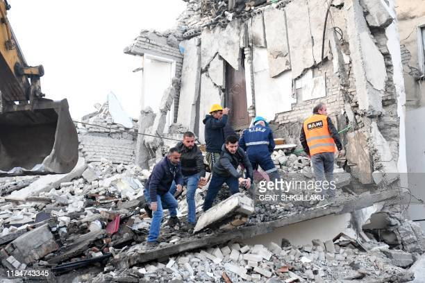 Emergency workers clear debris at a damaged building in Thumane, 34 kilometres northwest of capital Tirana, after an earthquake hit Albania, on...