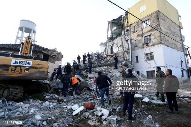 Emergency workers clear debris at a damaged building in Thumane 34 kilometres northwest of capital Tirana after an earthquake hit Albania on November...
