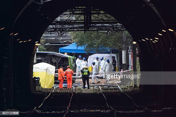 Emergency workers continue to work at the scene of a tram crash on November 10 2016 in Croydon England Seven people were killed and more than 50...
