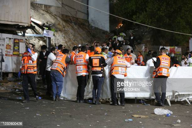 Emergency workers gather at the scene after dozens of people were killed and others injured after a grandstand collapsed in Meron, Israel, where tens...