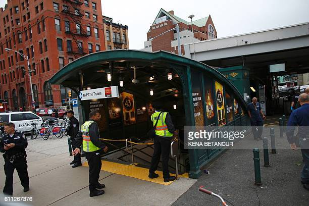 Emergency workers gather outside New Jersey Transit's rail station in Hoboken New Jersey September 29 2016 A commuter train crashed into a station in...