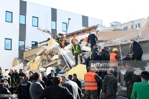 Emergency workers look for survivers trough the debris at a damaged building in the coastal city of Durres, west of capital Tirana, after an...