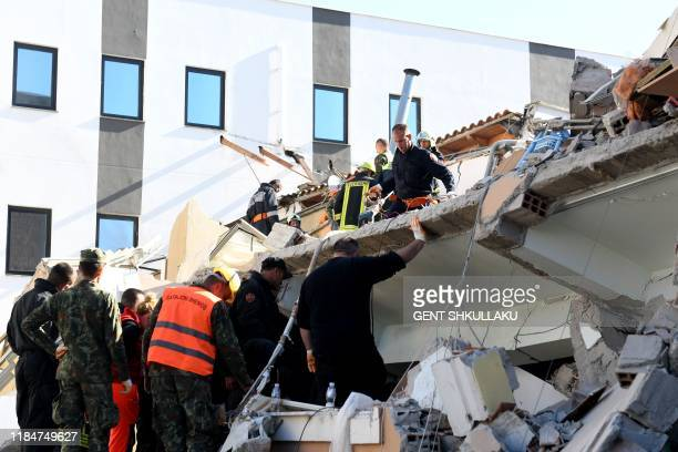 Emergency workers look for survivers trough the debris at a damaged building in the coastal city of Durres west of capital Tirana after an earthquake...