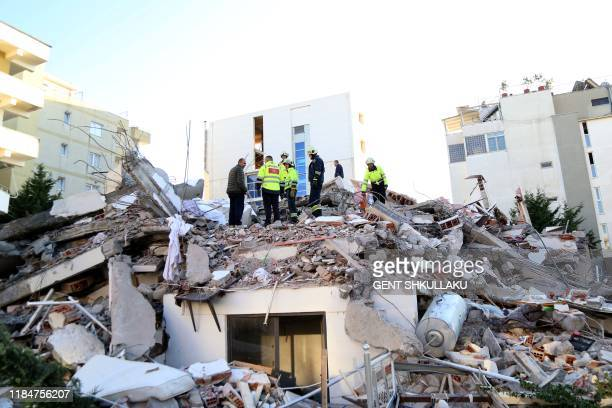 Emergency workers look for survivors trough the rubble of a building in the coastal city of Durres west of capital Tirana following an earthquake on...