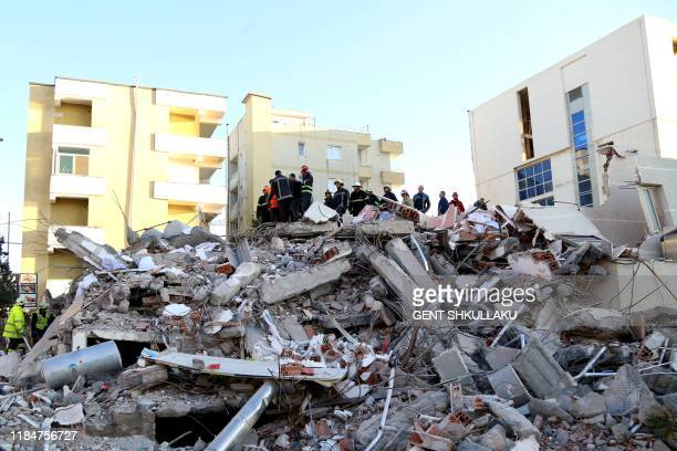 Emergency workers look for survivors trough the rubble of a damaged building in the coastal city of Durres, west of capital Tirana, after an...