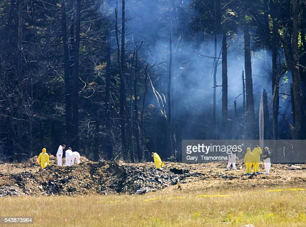 Emergency workers look over the site where the Boeing 757 of United Airlines crashed near Shanksville Pennsylvania