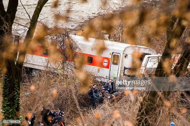 Emergency workers remove a dead body from the wreckage after a Metro-North commuter train derailed just north of the Spuyten Duyvil station December...