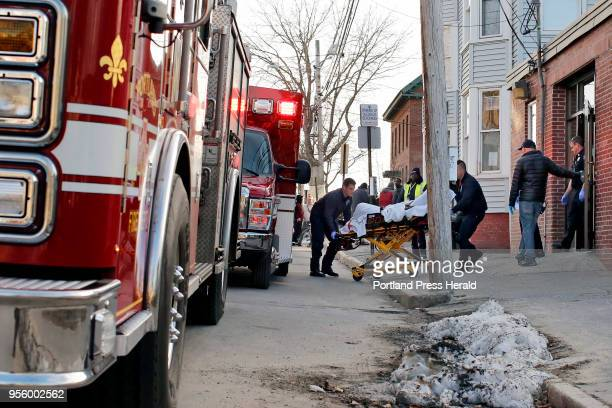 Emergency workers remove a patient from Oxford Street Shelter who had overdosed on heroin The patient was revived with Narcan Director Rob Parritt...