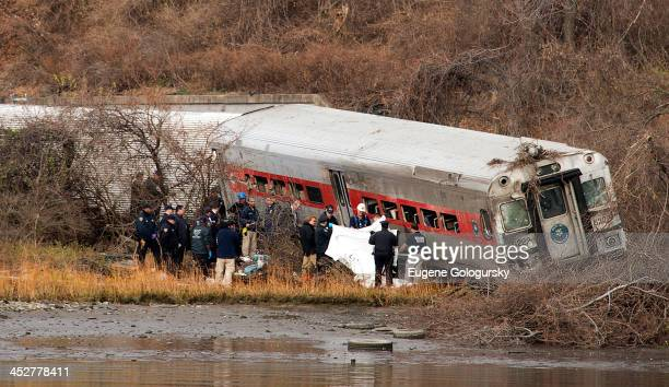 Emergency workers respond to the scene of a MetroNorth commuter train derailment just north of the Spuyten Duyvil station December 1 2013 in the...