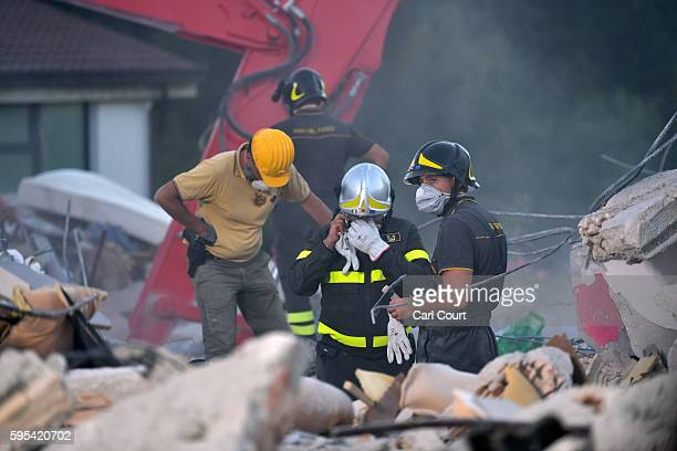 Emergency workers search the rubble of a building that was destroyed during an earthquake on August 25, 2016 in Amatrice, Italy. The death toll in...