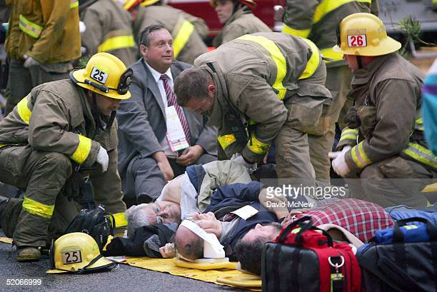 Emergency workers treat victims of a commuter train wreck at a triage on January 26 2005 in Glendale California The wreck involving two commuter...
