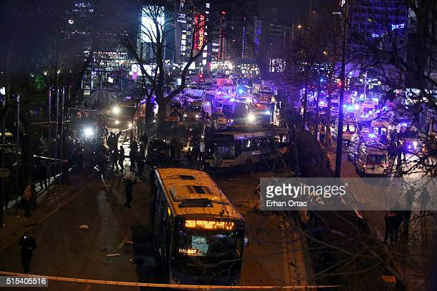 Emergency workers work at the scene of an explosion March 13 2016 in in Ankara Turkey At least 27 people were killed and 75 wounded in an explosion...