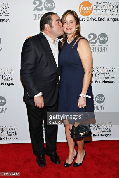 Emeril Lagasse and Alden Lovelace attend Food Networks 20th birthday celebration at Pier 92 on October 17 2013 in New York City