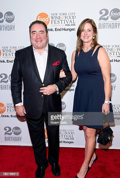 Emeril Lagasse and Alden Lovelace attend Food Network's 20th birthday celebration at Pier 92 on October 17 2013 in New York City