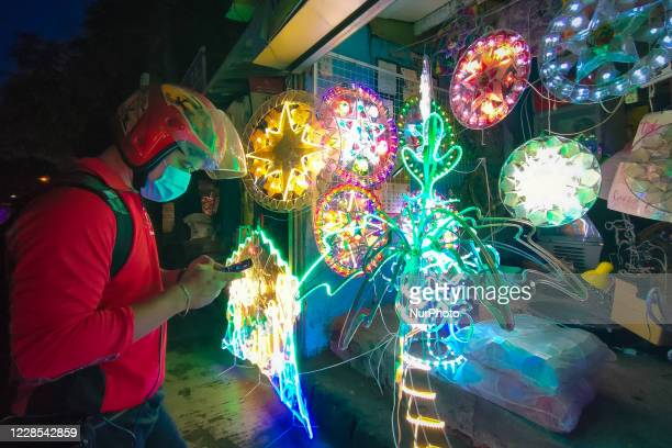 Emerson, a fast food delivery driver in Cainta, Rizal bought their family's first christmas lantern in Antipolo City, Philippines on September 16,...