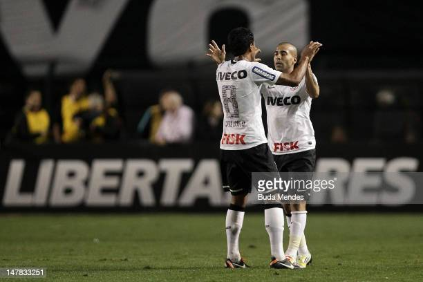 Emerson and Paulinho of Corinthians celebrate a scored goal during the second leg of the final of the Copa Libertadores 2012 between Boca Juniors of...