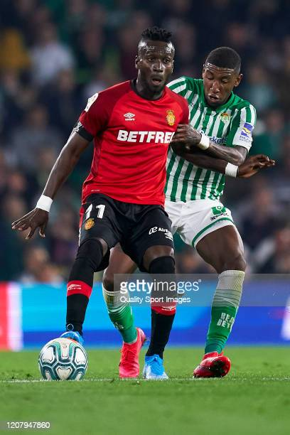 Emerson de Souza of Real Betis competes for the ball with Lago Junior of RCD Mallorca during the La Liga match between Real Betis Balompie and RCD...