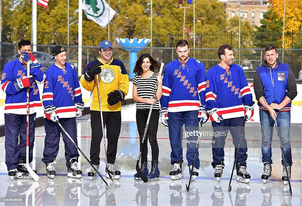 Emerson Etem, Antti Raanta, Mark Gessner, Lindsey Broad, Dylan McIlrath, Jarrett Stoll and Chris Distefano attend the New York Rangers and the Cast of IFCÕs Hockey Comedy Benders Face Off event at Lasker Rink on October 29, 2015 in New York City.