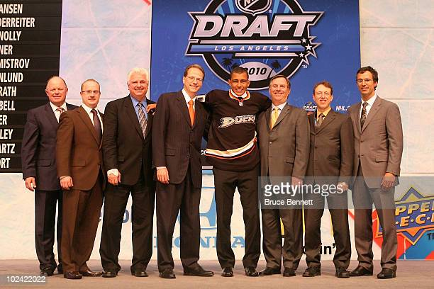 Emerson Etem drafted 29th overall by the Anaheim Ducks poses on stage with team personnel during the 2010 NHL Entry Draft at Staples Center on June...