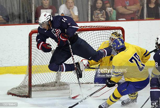 Emerson Etem of Team USA flies past Johan Gustafsson of Team Sweden at the Lake Placid Olympic Center on August 10, 2011 in Lake Placid, New York....