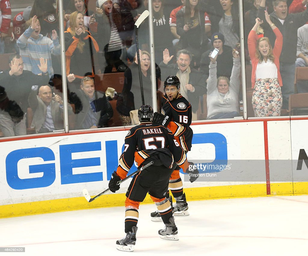 Emerson Etem #16 of the Anaheim Ducks celebrates with Rikard Rakell #57 after scoring a third period goal against the Detroit Red Wings at Honda Center on February 23, 2015 in Anaheim, California. The Ducks won 4-3 in a shootout.
