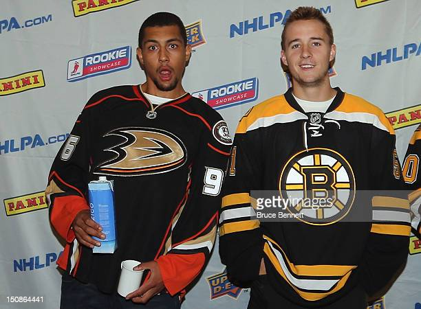 Emerson Etem of the Anaheim Ducks clowns around with Ryan Spooner of the Boston Bruins meets with the media at the 2012 NHLPA rookie showcase at the...