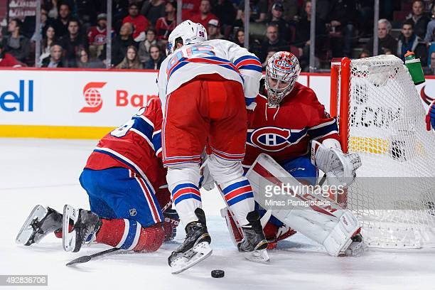 Emerson Etem of the New York Rangers blocks goaltender Carey Price of the Montreal Canadiens during the NHL game at the Bell Centre on October 15...