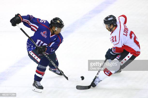 Emerson Etem of the USA and Josh Lunden of Canada compete for the puck during the International Ice Hockey Series match between the USA and Canada at...