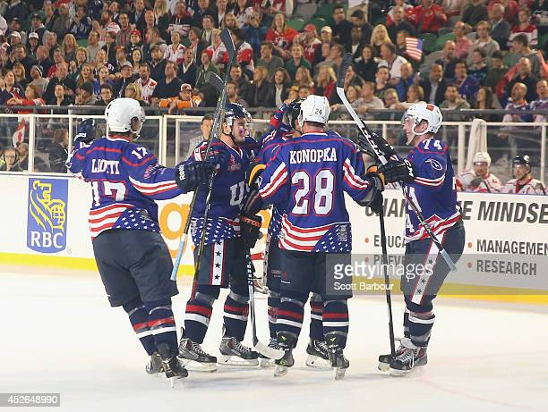 Emerson Etem of the USA is congratulated by his team mates after scoring a goal during the International Ice Hockey Series match between the United...