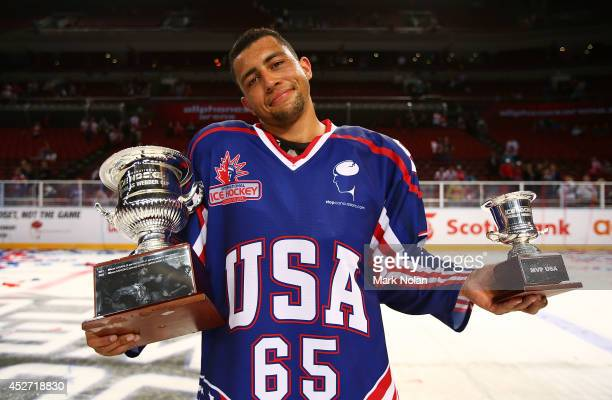 Emerson Etem of the USA poses with the Douglas Webber Cup and the MVP award for the USA after the USA won the International Ice Hockey Series between...