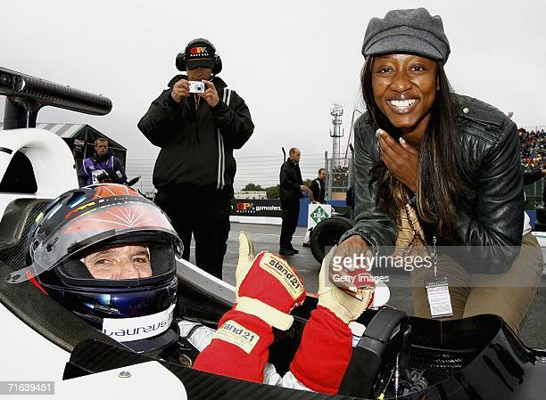Emerson Fittipaldi and Beverley Knight pose for a picture during the GP Masters of Great Britain at Silverstone circuit on August 13 in Silverstone...
