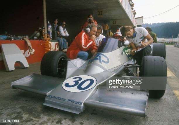 Emerson Fittipaldi of Brazil aboard the Copersucar Fittipaldi Fittipaldi FD04 Ford Cosworth DFV V8 talks with his engineer David Baldwin and chief...