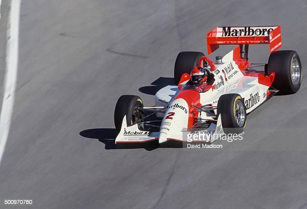 Emerson Fittipaldi of Brazil and Marlboro Team Penske drives car in the Corkscrew turn at the Laguna Seca Raceway during the 1994 Toyota Grand Prix...