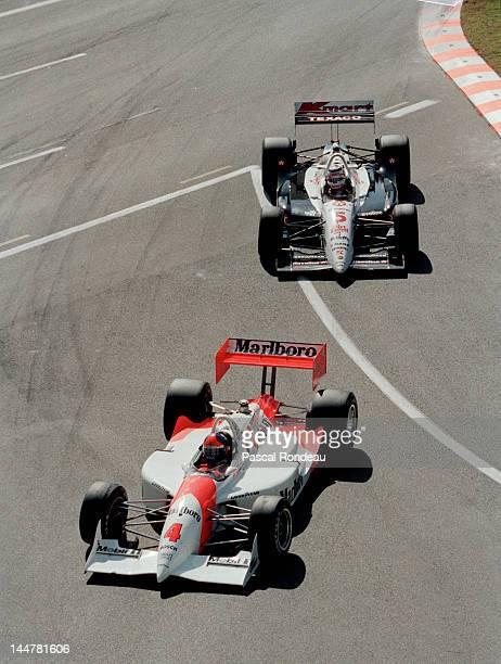 Emerson Fittipaldi of Brazil drives the Marlboro Team Penske Penske PC2293 ChevroletIlmor ahead of Nigel Mansell of Great Britain in the Newman Haas...