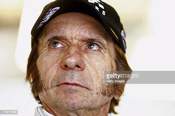 Emerson Fittipaldi waits in the pits during testing for the GP Masters of Great Britain at Silverstone circuit on August 10 in Silverstone England